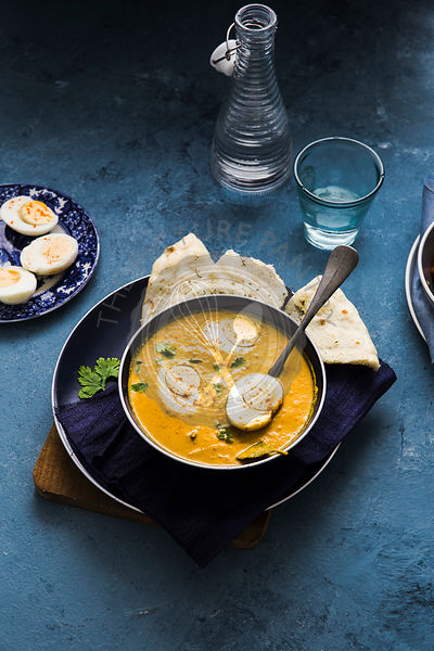 Egg Curry served with Naan Bread