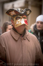Man in the crowd wearing a Carnival Mask in Venice