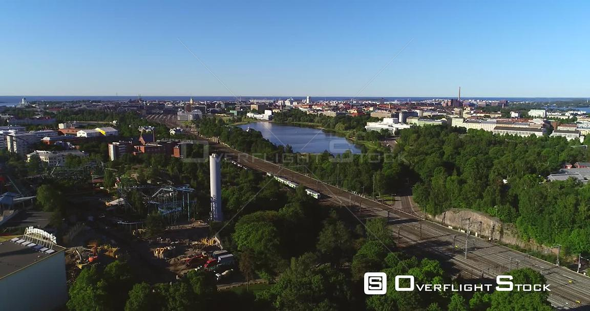 Train in a City, Aerial Tracking View Following a Train Leaving the Railway Station, in Helsinki, on a Sunny Summer Morning Dawn, in Helsingfors, Uusimaa, Finland