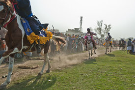 A nihang (sikh warrior) shows off his skills in front of the crowd during the festival of Holla Mohalla, Anandpur Sahib