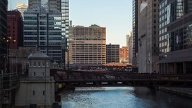 Medium Shot: Looking Down The Chicago RIver At The Old Sun Time's Building