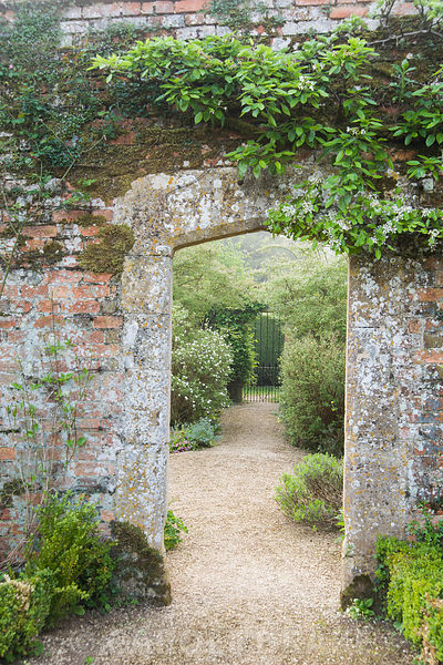 Doorway in brick wall between Vegetable Garden and Walled Garden. Rousham House, Bicester, Oxon, UK
