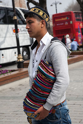 Young man selling embroidered hats, Istanbul