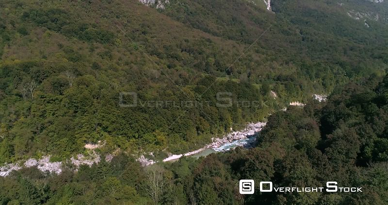 Alpine rapids, C4K aerial tilt down, drone view towards a turquoise, soca river, in the slovenian alp nature, near Trigolov national park, on a sunny summer day, in the Julian alps, Slovenia
