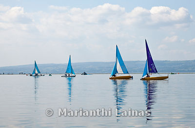 Four blue sailing boats