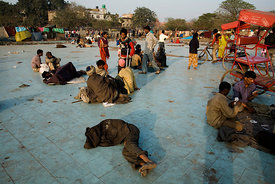 India - Delhi - Homeless and destitute men and women gather in a square near the Jama Masjid to sleep, drink and take drugs
