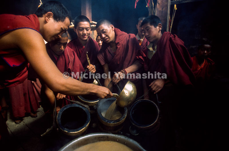 Songzanlin Lamasery also known as Guihua Monastery. The biggest in Yunnan Province, over 800 lamas. Making yak butter tea..Zhongdian, Yunnan, China