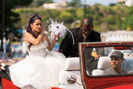 A bride and a groom on a openair wedding car in Old Havana, Cuba.