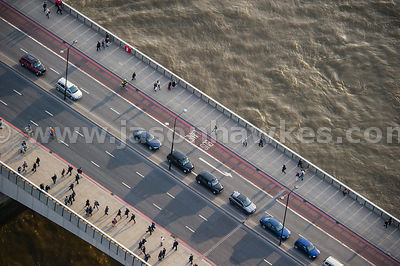 Aerial view of commuters walking over London Bridge