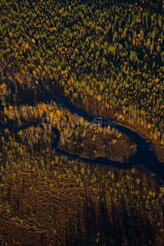 Aerial view of river and taiga woodland, Laponia / Lappland , Finland