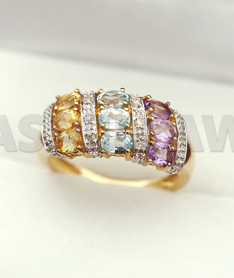 Beautiful gold ring with gemstones and diamonds - citrine, aquamarine and amethyst in jewelry box