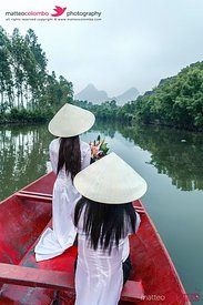 Young vietnamese girls on a boat on a river, Vietnam