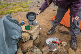 Pouring Hot Water to Make Breakfast Coffee and Tea While Backpacking