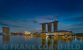SINGAPORE CITY, SINGAPORE - OCTOBER 08, 2016: The waterfront at Marina Bay complex with modern hotel, retail outlets and restaurants.  There is a regular laser show each evening from the roof of the hotel.