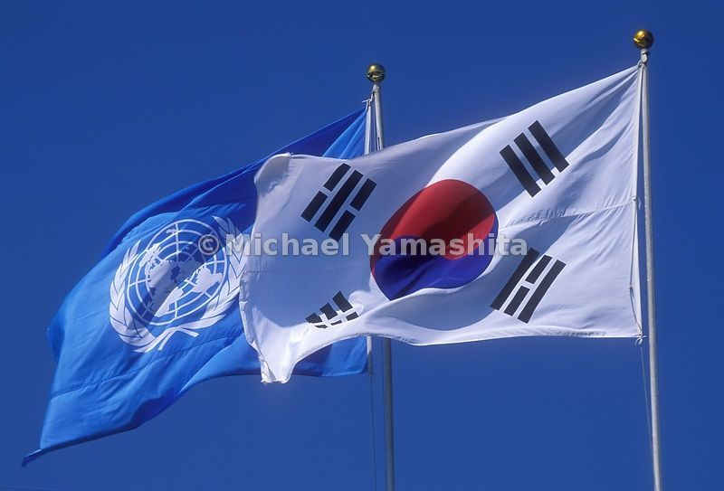Republic of Korea flag and the flag of the United Nations. Taesongdong.