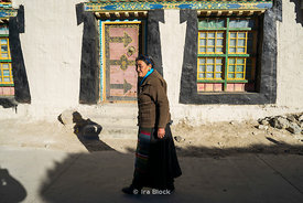 A woman on the street in the town of Tingri, Tibet.