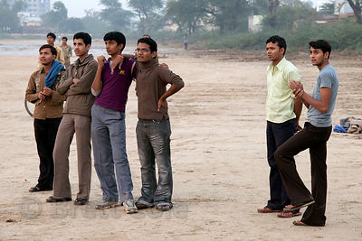 Young men congregating in a field in Bharatpur, Rajasthan, India