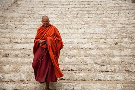 "A monk on the street around Punakha Dzong (meaning ""the palace of great happiness or bliss"") in Punakha, Bhutan."