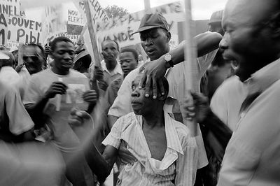 Haiti - Port Au Prince - A man being assaulted during a demonstration