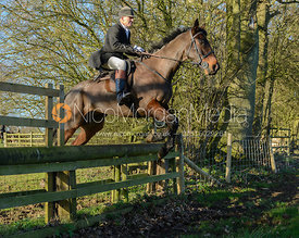 John Knowles jumping a hunt jump in Pickwell
