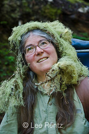 "Karen Rentz with Usnea lichen (Usnea longissima) ""hair"" in the Perry Creek Research Natural Area of Mt. Baker-Snoqualmie National Forest, Cascade Mountains, Washington, USA, August, 2008_WA_4555"