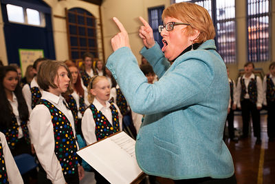 UK - Scunthorpe - Sue Hollingsworth, head of the Scunthorpe Cooperative Junior Choir leads a rehearsal for a production of Cycle Opera at Henderson Avenue Primary School