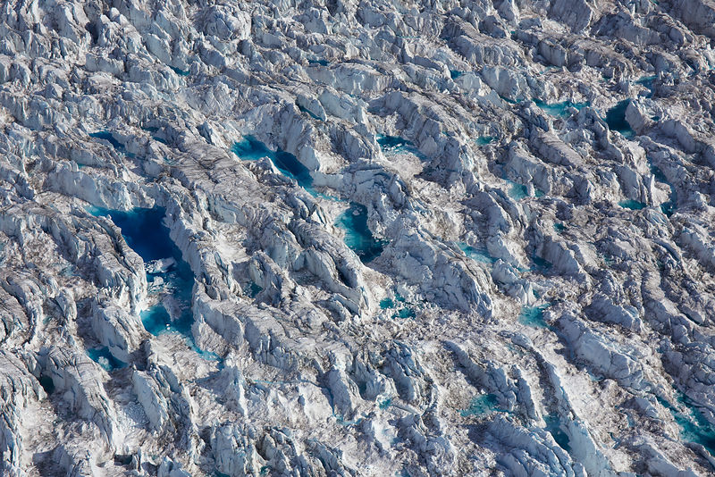 Aerial view of crevasses with meltwater on the Sermeq Kujalleq Glacier or Jakobshavn Isbrae, near Ilulissat Icefjord UNESCO World Heritage Site, Greenland. August 2014.