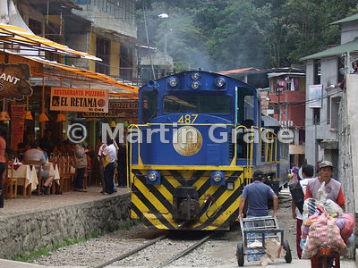 Train on the railway line street in Aguas Calientes, Peru