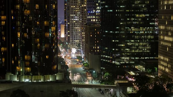Close Up: Traffic At The Bottom Of A Canyon Of High-Rises
