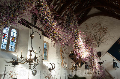 60' long dried flower garland made from over 30,000 dried flowers and grasses inserted into a pittosporum base haning in the Great Hall at Christmas. Cotehele, St Dominick, nr Saltash, Cornwall, UK