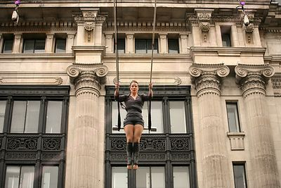 Aerial Performer in Trapeze Act in a Central London Street