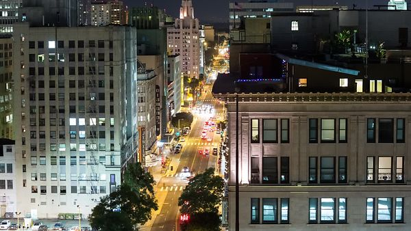 Bird's Eye: Penthouse Overlooking A Busy Broadway Street