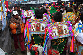Dancers with bead embroidered square hats (called an aqarapi) during Qoyllur Riti festival, Peru