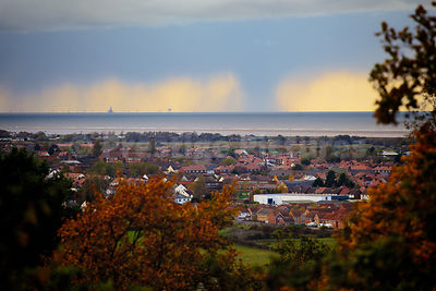 Panoramic Shot  Across Housing with a Storm Hanging over the Distant Irish Sea