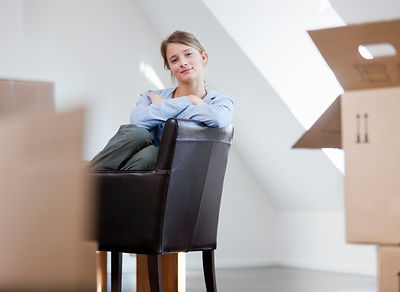 Woman sitting in chair in new house
