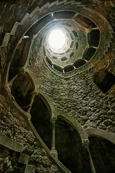 The Initiation Well or Inverted Tower in the gardens of Quinta da Regaleira.Sintra, Portugal