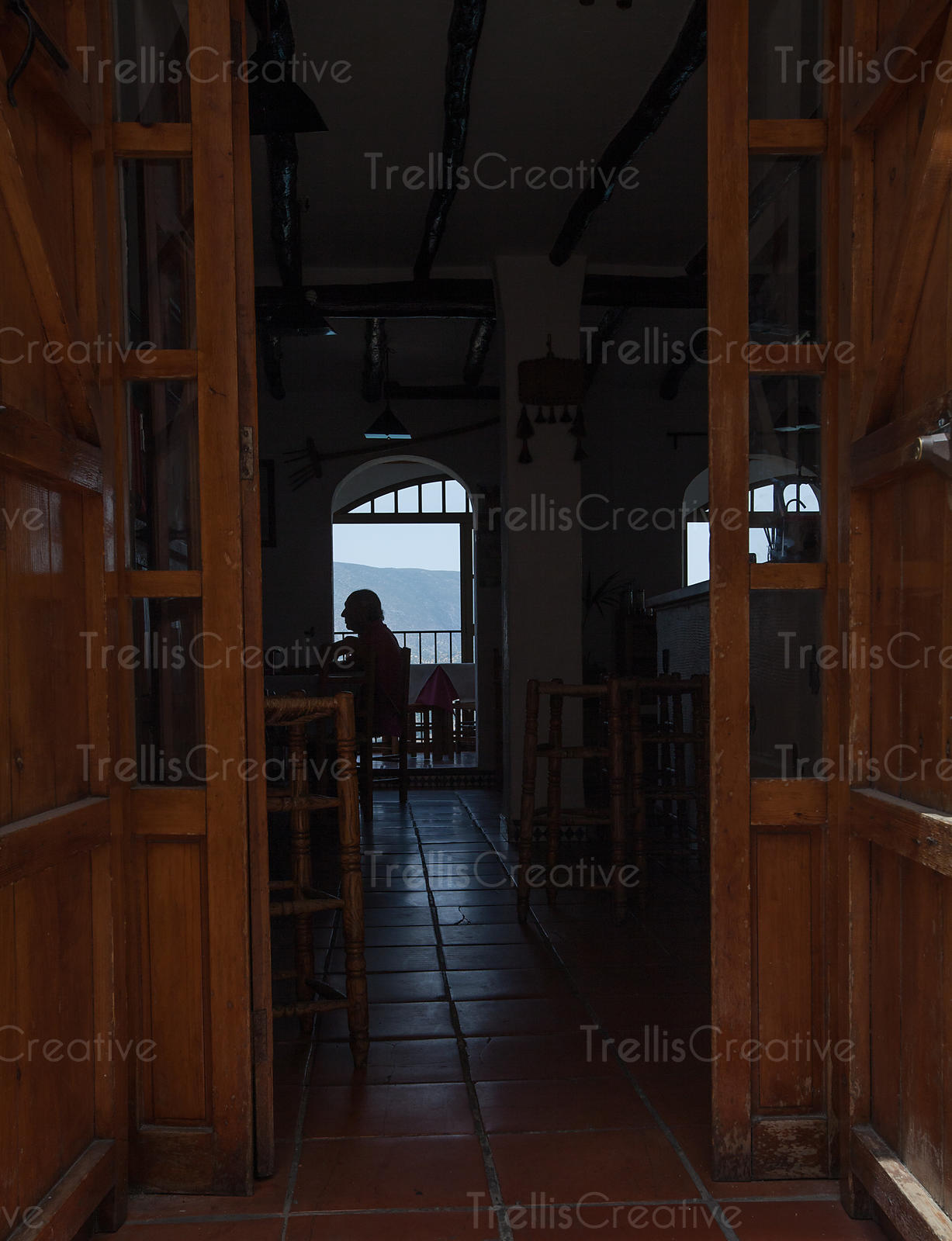 Silhouette of a man sitting in a restaurant