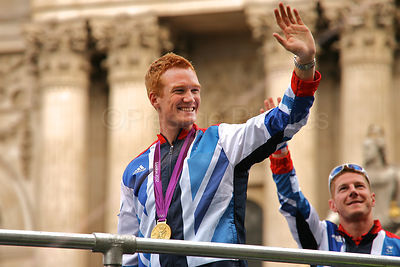 Champion long jumper Greg Rutherford waves to the Crowd During the Athletes Victory Parade in London