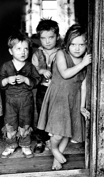 Kids in doorway, barefoot