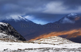 Storm clouds over the summits of Meall Mheinnidh and Bealach Mheinnidh in the Scottish Highlands, Scotland, UK.