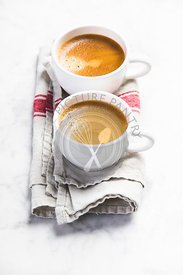 Coffee composition on white marble background. Coffee espresso in white cups