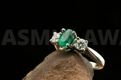 Ring with emerald and diamonds set in white gold ..Engagement/Wedding Ring..Shallow DOF