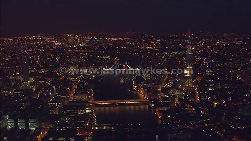 Aerial footage of Tower Bridge at night, London, England, UK