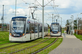 EDINBURGH, SCOTLAND – APRIL 16, 2016: Two Edinburgh tramcars at Gyle Centre station to the west of the city.