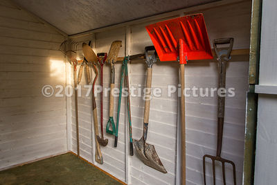 Inside a Smart Garden Shed with Garden Tools Heanging Neatly