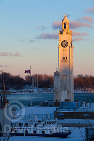 Montreal's Old Port (Vieux Port) clock tower at sunset, beside the Saint Laurence river (Fleuve Saint-Laurent)