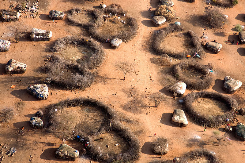 Samburu manyatta as seen from the air illustrates the parched conditions in northern Kenya. The worst drought (2008-2009) in more than a decade killed most of the Samburu tribeman's livestock and threatens their own survival. August 2009.