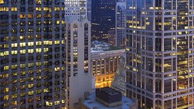 Bird's Eye: Concrete & Glass Caverns Gracefully Illuminate Chicago City Hall (Day to Night)