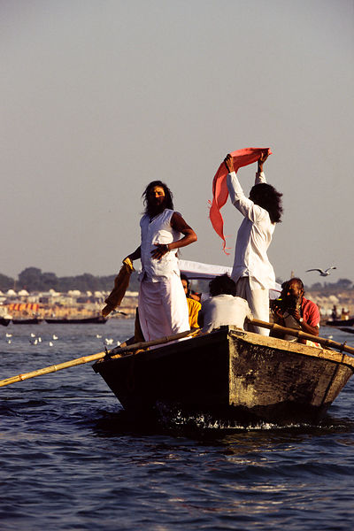 Saddhus in a boat at the Kumbh Mela. Ardh Kumbh Mela 1995, Allahbad, India