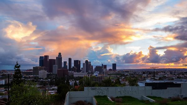 Wide Shot: Rare Cumulo-Numbus Clouds Dominating A Colorful Sunset Over Downtown L.A. (Day To Night)
